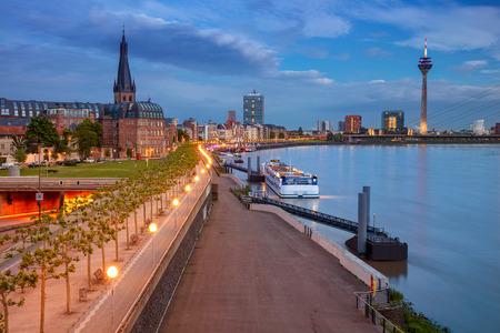Cityscape image of riverside Düsseldorf, Germany with Rhine river during sunset, Dusseldorf, Germany. Stock Photo