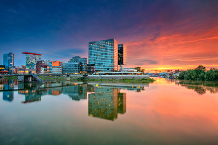Cityscape image of Düsseldorf, Germany with the Media Harbour and reflection of the city in the Rhine river, during beautiful sunset, Dusseldorf, Germany. Stock Photo