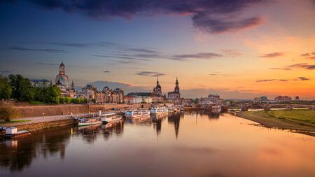 Dresden, Germany. Panoramic  cityscape image of Dresden, Germany with reflection of the city in the Elbe river, during sunset. Stock Photo - 127905689