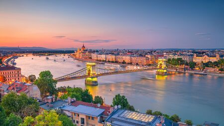 Aerial cityscape image of Budapest panorama with Chain Bridge and parliament building during summer sunset. Stock Photo