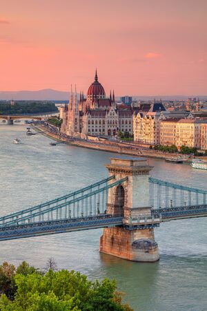Budapest, Hungary. Aerial cityscape image of Budapest with Szechenyi Chain Bridge and parliament building during summer sunset. Stock Photo - 130555645