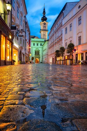 Linz, Austria. Cityscape image of old town Linz, Austria during twilight blue hour with reflection of the city lights. Stock Photo