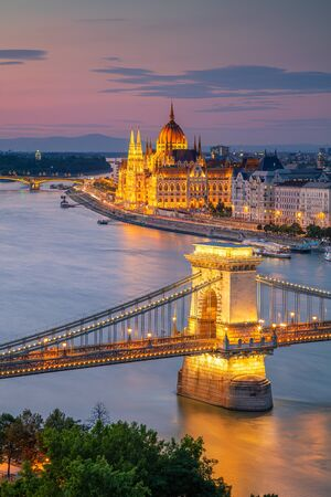 Budapest, Hungary. Aerial cityscape image of Budapest with Szechenyi Chain Bridge and parliament building during summer sunset.