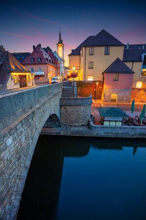 Wurzburg, Germany. Cityscape image of Wurzburg with Old Main Bridge over Main river during beautiful sunrise.