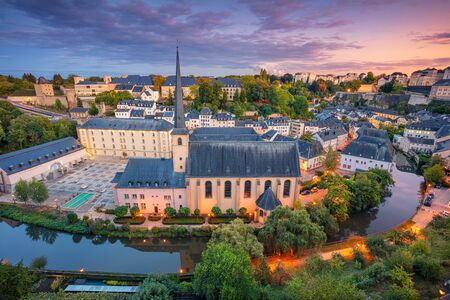 Luxembourg City, Luxembourg. Aerial cityscape image of old town Luxembourg City skyline during beautiful sunset. Stock Photo