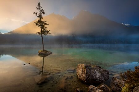 Lake Hintersee, German Alps, Germany. Image of Lake Hintersee located in southern Bavaria, Germany during autumn sunrise. Stock Photo