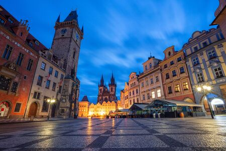 Prague, Czech Republic. Cityscape image of famous Old Town Square with the Prague Astronomical Clock and Old Town Hall during twilight blue hour.
