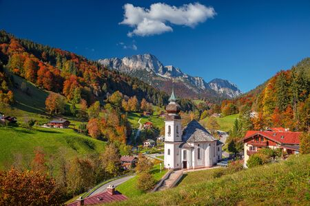 Autumn in Alps. Image of the Bavarian Alps with Maria Gern Church during beautiful autumn day.
