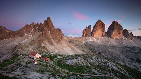 The Three Peaks of Lavaredo. Amazing panorama of Italian  Dolomites with famous Three Peaks of Lavaredo (Tre Cime di Lavaredo) South Tyrol, Italy, Europe at summer twilight. Banco de Imagens