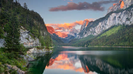 Gosausee, European Alps. Panoramic image of Gosausee, Austria located in European Alps at summer sunset. Stock Photo