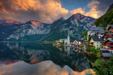 Hallstatt, Austria. Image of famous alpine village Hallstatt at dramatic summer sunset.