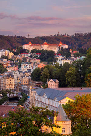 Karlovy Vary, Czech Republic. Aerial image of Karlovy Vary (Carlsbad), located in western Bohemia at beautiful summer sunset. Stock Photo