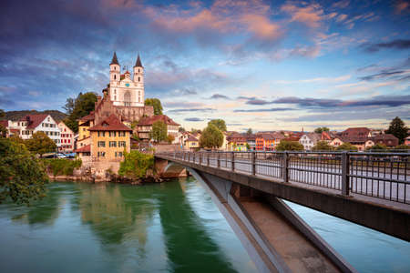Aarburg, Switzerland. Cityscape image of beautiful city of Aarburg with the reflection of the city in the Aare river at sunset.
