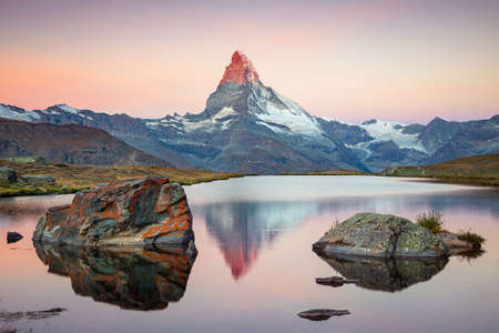Matterhorn, Swiss Alps. Landscape image of Swiss Alps with Stellisee and Matterhorn in the background during sunrise. Stock Photo