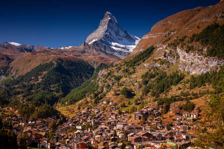 Zermatt, Switzerland. Image of iconic village of Zermatt, Switzerland with the Matterhorn in the background at beautiful sunny autumn day.