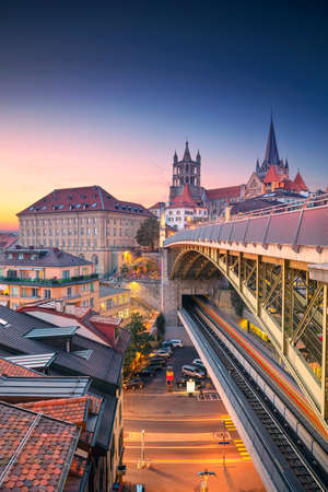 City of Lausanne. Cityscape image of downtown Lausanne, Switzerland during beautiful autumn sunset. Stock Photo