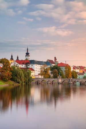 Pisek, Czech Republic. Cityscape image of Pisek with famous Stone Bridge at beautiful autumn sunset.