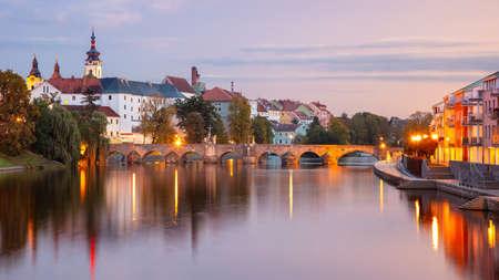Pisek, Czech Republic. Panoramic cityscape image of Pisek with famous Stone Bridge at beautiful autumn sunset. Banco de Imagens