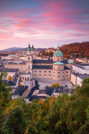 Salzburg, Austria. Cityscape image of the Salzburg, Austria with Salzburg Cathedral during autumn sunset. Stock Photo