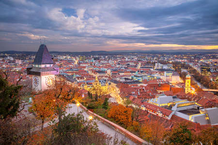 Graz, Austria. Cityscape image of the Graz, Austria with the Clock Tower at beautiful autumn sunset.