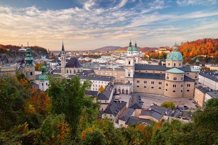 Salzburg, Austria. Cityscape image of the Salzburg, Austria with Salzburg Cathedral at autumn sunset. Stock Photo