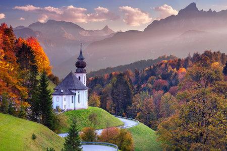 Bavarian Alps. Landscape image of the Bavarian Alps with Maria Gern Church and Watzmann mountain during beautiful autumn sunset.