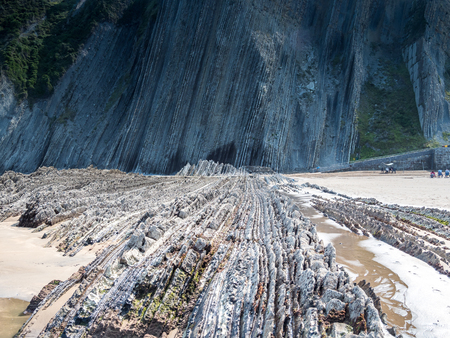 The Itzurum Flysch in Zumaia - Basque Country. Flysch is a sequence of sedimentary rock layers that progress from deep-water and turbidity flow deposits to shallow-water shales and sandstones. Banco de Imagens