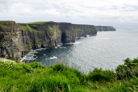World famous Cliffs of Moher, one of the most popular tourist destinations in Ireland. view of widely known tourist attraction on Wild Atlantic Way in County Clare. Stock Photo