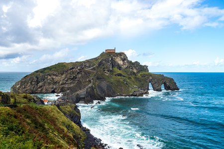 Bermeo, Basque Country, Spain: Monastery of San Juan de Gaztelugatxe on an islet on the coast of Biscay connected to the mainland by a man made bridge.