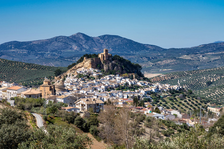 The spectacular Spanish town of Montefrio with its whitewashed houses and its sixteenth century clifftop church, the Iglesia de la Villa, in the Granada region of Andalucia. 写真素材