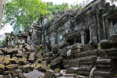 Ruins of ancient Beng Mealea Temple over jungle, Cambodia. Beng Mealea is a temple in the Angkor Wat style located 40 km east of the main group of temples at Angkor, its name means lotus pond