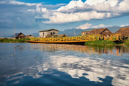 Wooden floating houses on Inle Lake in Shan, Myanmar. Inle Lake is a freshwater lake located in the Nyaungshwe Township of Taunggyi District of Shan State. Reklamní fotografie