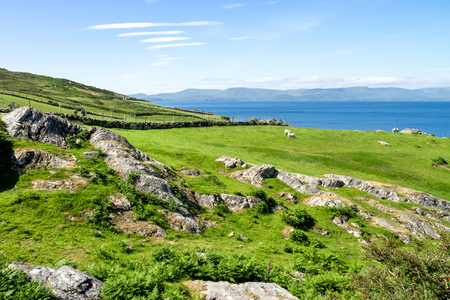 Landscape view in West Kerry, Beara peninsula, popular holiday home destination in Ireland for short trips weekend road family drives. Surrounded by Nature, mountains, cliffs and ocean
