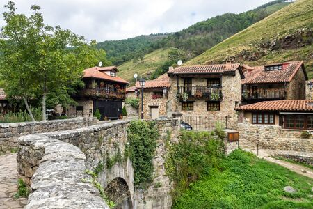 Barcena Mayor, Cabuerniga valley, with typical stone houses is one of the most beautiful rural village in Cantabria, Spain. Stok Fotoğraf
