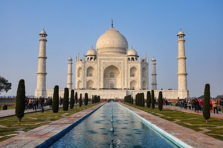 Taj Mahal is a white marble mausoleum on the bank of the Yamuna river in Agra city, Uttar Pradesh state, India 免版税图像