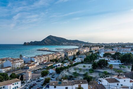 The beautiful rocky beach of Altea that is a small town in Alicante in Spain, showing the coast and beach that is commonly know as Nueva Playa De Altea.