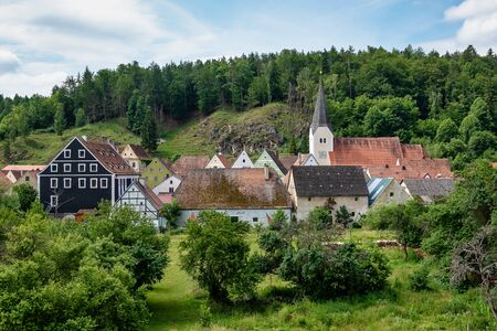 View on the town of Hohenburg, Upper Palatinate in Bavaria, Germany. Church, various buildings around the market, and castle ruin can be seen. Stockfoto