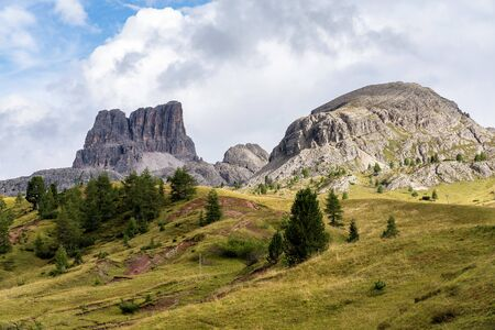 Passo Falzarego at sunny autumn day. Panoramic view. Dolomites, Italy
