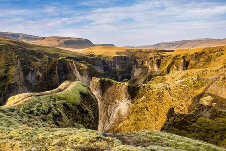 Unique landscape of Fjadrargljufur in Iceland. Top tourism destination. Fjadrargljufur Canyon is a massive canyon about 100 meters deep and about 2 kilometers long, located in South East of Iceland. 版權商用圖片
