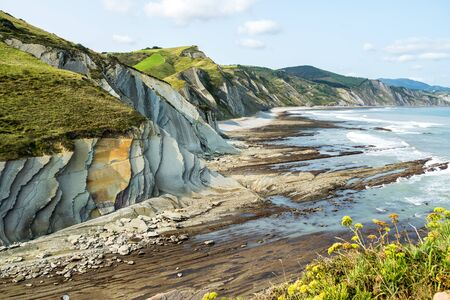 The Acantilado Flysch in Zumaia - Basque Country. Flysch is a sequence of sedimentary rock layers that progress from deep-water and turbidity flow deposits to shallow-water shales and sandstones.