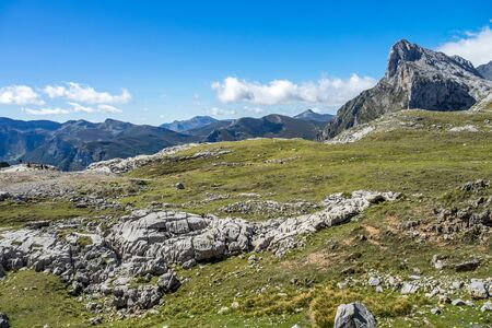 Fuente De in the in mountains of Picos de Europa, Cantabria, Spain. In the heart of the Picos de Europa, we find impressive landscapes of valleys and green meadows, rocky mountains and grazing cattle.