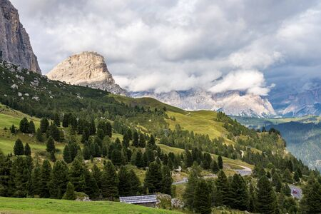view of Sella group mountain range or Gruppo del Sella and Gardena pass or Grodner Joch, South Tirol, Dolomite Alps, Italy