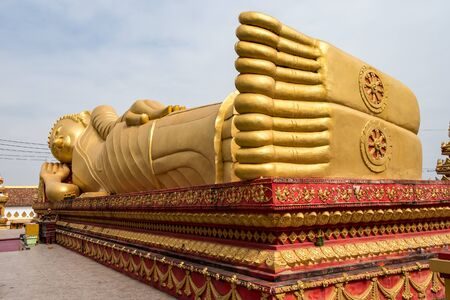 sleeping buddha statue at Wat Pha That Luang Temple - Great golden stupa or pagoda. The most important national monument and a national symbol in Vientiane, Laos