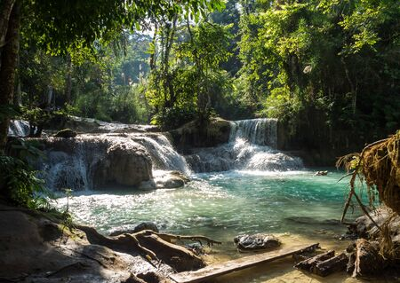 Tat Kuang Si Falls near Luang Prabang, Laos - Exotic travertine turquoise blue cascading waterfalls in Asia. Banco de Imagens - 128599263