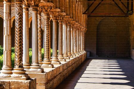 The courtyard of Monreale cathedral of Assumption of the Virgin Mary, Sicily, Italy.