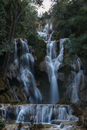 Tat Kuang Si Falls near Luang Prabang, Laos - Exotic travertine turquoise blue cascading waterfalls in Asia. Banco de Imagens - 128590863