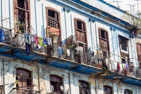 Old living colorful houses across the road in the center of Havana, Cuba Stock Photo