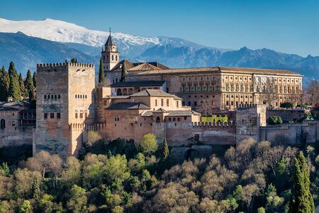 View of Alhambra Palace in Granada, Spain with Sierra Nevada mountains at the background Stok Fotoğraf
