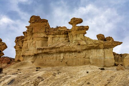 View of the rock formations Erosions of Bolnuevo, Las Gredas, Mazarron. Murcia, Spain. Wind and sun can be great sculpture artists. Imagens