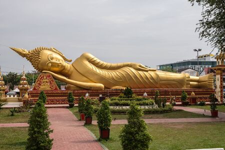 sleeping buddha statue at Wat Pha That Luang Temple in Vientiane, Laos 스톡 콘텐츠